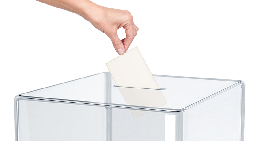 voto urna mano